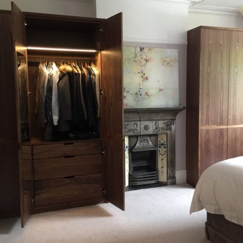 Wide view of room with wardrobes