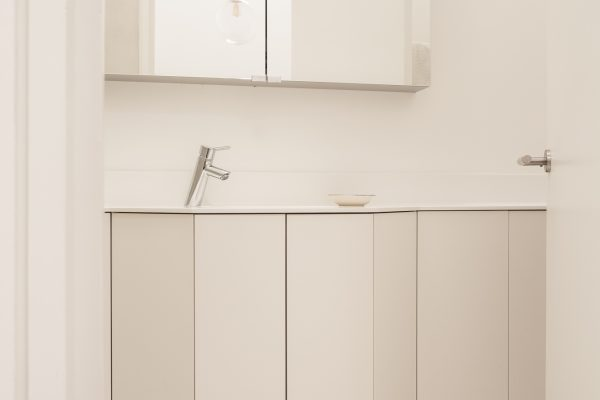 Bathroom sink, cabinet, and cupboards